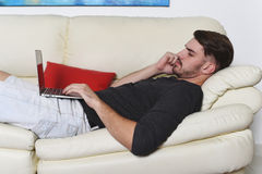 Young handsome man using his laptop Royalty Free Stock Images