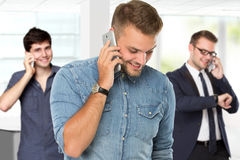 Young handsome man using mobile phone to call royalty free stock image