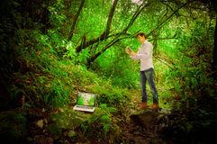 Young handsome man using tablet and laptop with Royalty Free Stock Images