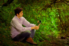 Young handsome man using tablet outdoors with Royalty Free Stock Photography
