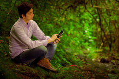 Young handsome man using tablet outdoors with Royalty Free Stock Images