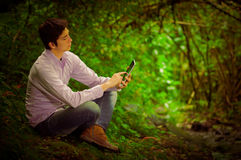 Young handsome man using tablet outdoors with Stock Photos