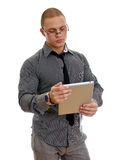 Young handsome man using tablet pc. Isolated on white Royalty Free Stock Photos