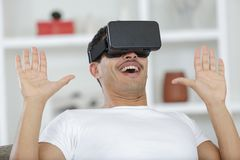 Young handsome man in virtual reality mask royalty free stock photography
