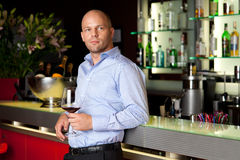 Young handsome man waiting next to the bar Stock Photo