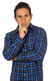 Young handsome man wearing a blue plaid shirt. Posing with hand on chin isolated on white Stock Photography