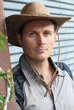 Young handsome man wearing cowboy hat Stock Image
