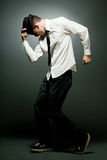 Young handsome man in white shirt dancing. Young happy handsome man in white shirt dancing royalty free stock image