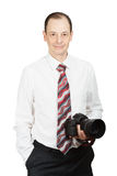 Young handsome man in white shirt with a tie and a photo camera Royalty Free Stock Photos