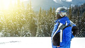 Young handsome man in winter sportswear looking away, wearing big mirrored ski mask.  Stock Images
