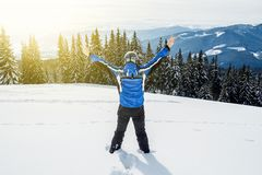 Young handsome man in winter sportswear looking away, wearing big mirrored ski mask.  Royalty Free Stock Image