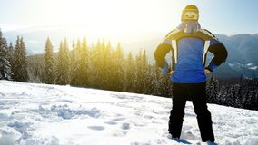Young handsome man in winter sportswear looking away, wearing big mirrored ski mask.  Stock Image