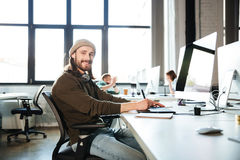 Young handsome man work in office using computer stock photography