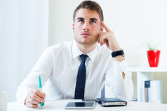 Young handsome man working in his office. Royalty Free Stock Photo