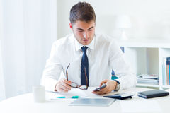 Young handsome man working in his office. Royalty Free Stock Photos