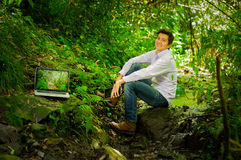 Young handsome man working with laptop and Royalty Free Stock Photo