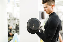 Young handsome man working out in a gym Stock Photo