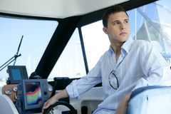 Young handsome man on a yacht boat interior Stock Images