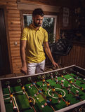 Young handsome man in yellow t-shirt playing on soccer. Stock Photos