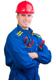Young handsome mechanic with hard hat and tools royalty free stock photography