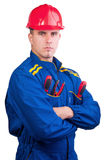 Young handsome mechanic with hard hat and tools royalty free stock photos