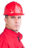 Young handsome mechanic with hard hat and tools and in overalls Stock Image