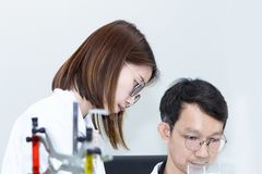 Young handsome medical student and research assistant taking royalty free stock photo