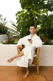 Young handsome men. Drinking wine after bath Stock Image