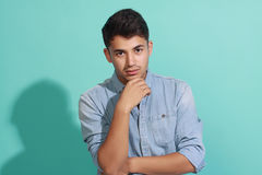 Young handsome men on blue background. Portrait of an attractive young man posing against blue background Stock Images