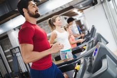 Young handsome man doing cardio training in gym royalty free stock photos