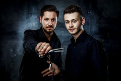 Young handsome men. Elegant young handsome men.  Man with straight razor and men holding hairdressers scisors Stock Photography