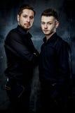 Young handsome men. Elegant young handsome men. Studio fashion photo Stock Photos