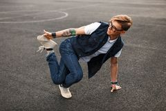 Young handsome man in stylish denim dress dancing hip hop. Young handsome men in stylish denim dress dancing hip hop royalty free stock images