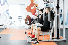 Young handsome men working out in a  gym Royalty Free Stock Photo
