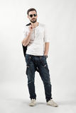 Young handsome model holding jacket over his shoulder Royalty Free Stock Images