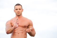 Young handsome muscular man Royalty Free Stock Photography