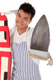 Young handsome Nepalese man, iron Stock Image