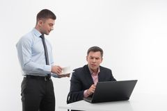 Young handsome office worker assistant brings Stock Images