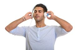 Young handsome Persian man listening to music with eyes closed. Isolated against white background royalty free stock photos