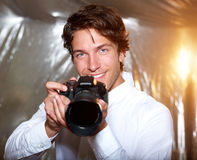Young handsome photographer Stock Photos