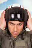 Young handsome pilot wearing helmet over sky Royalty Free Stock Images
