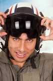 Young handsome pilot wearing helmet over sky Royalty Free Stock Image