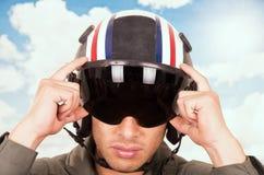 Young handsome pilot wearing helmet over sky Stock Photo