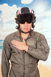 Young handsome pilot wearing uniform and helmet Royalty Free Stock Photography