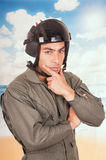 Young handsome pilot wearing uniform and helmet Royalty Free Stock Photo