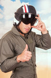 Young handsome pilot wearing uniform and helmet Stock Photography