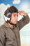 Young handsome pilot wearing uniform and helmet Royalty Free Stock Image