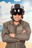 Young handsome pilot wearing uniform and helmet Stock Photos