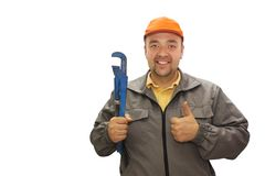 Young handsome plumber worker with adjustable wrench. Isolated over white background. Royalty Free Stock Photo