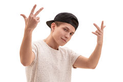 Young handsome rap dancer in black baseball cap. Showing dance moves studio portrait Stock Photos